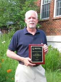 Rich Elliott poses with his Cordner Nelson Book Award