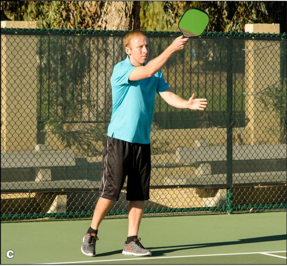 Figure 4.4 The lob serve: () preparation, () contact, and () follow-through.