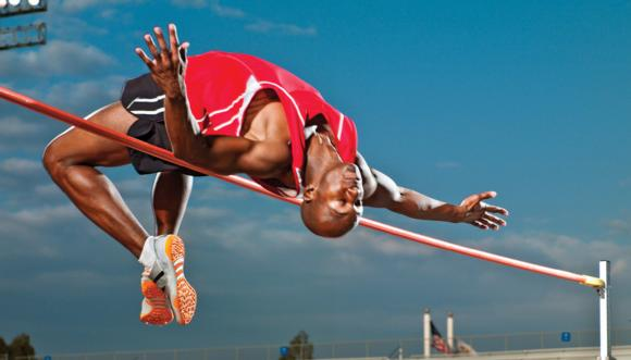 Figure 7.11 The high jumper's hips lift upward when the upper and lower body flex downward.