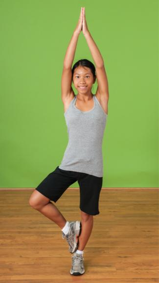 Figure 5.3 Yoga is one type of physical activity for improving flexibility.