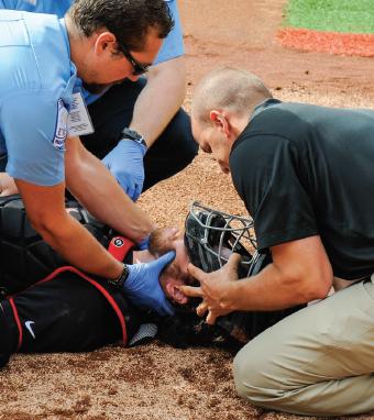 Figure 9.26 Helmet removal: baseball catcher.